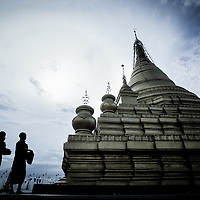 USE ARROWS ← → on your keyboard to navigate this slide-show<br /> <br /> Mandalay, Myanmar (Burma) May 2006<br /> Two buddhist monks walk in a temple of the Burmese ancient capital Mandalay.<br /> Photo: Ezequiel Scagnetti