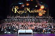Koningin Maxima is aanwezig bij de BZT Kerstshow in Carre Amsterdam. De BZT Band XXL is compleet! Tien muzikale groepen, met elk een eigen 'sound', treden aanstaande op in een vol Carré op het Kerst Muziekgala 2016 als onderdeel van Meer muziek in de klas.<br /> <br /> Queen Maxima attends the BZT Christmas Show in Amsterdam Carre. The BZT Band XXL is complete! Ten musical groups, each with its own 'sound', stairs leading into a full Carré in Christmas music gala 2016 as part of more music in class.<br /> <br /> Op de foto / On the photo: Koningin Maxima met de BZT Band XXL //// Queen Maxima with the BZT Band XXL