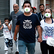 A man and girl friend rushes away from tear gas during protesters' clashes with police on Istiklal Avenue in Istanbul on July 6, 2013. Turkish riot police fired tear gas and water cannons Saturday to disperse some 3,000 demonstrators who tried to enter flashpoint protest spot Taksim Square in Istanbul. The group had gathered on the Istiklal Avenue pedestrian way that leads to the square, the site of nearly three weeks of protests against Prime Minister Recep Tayyip Erdogan and his Islamic-rooted government that left four people dead and some 8,000 injured. Photo by AYKUT AKICI/TURKPIX