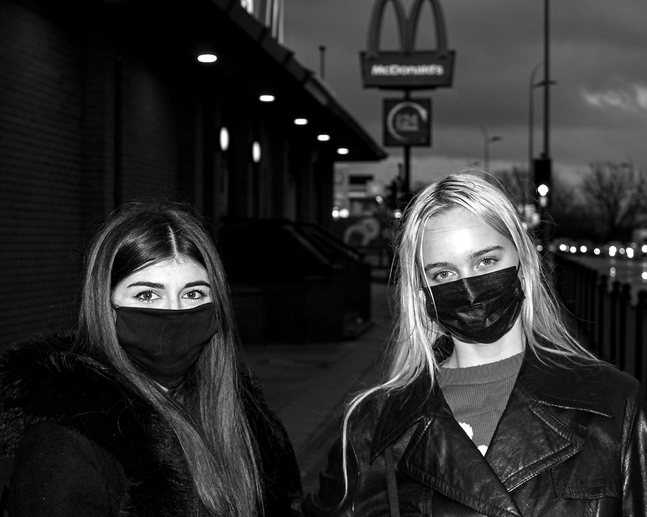 Alex Pye and Gabi Celikovaite wear face masks while going to their local McDonald's for a catch up over some food.