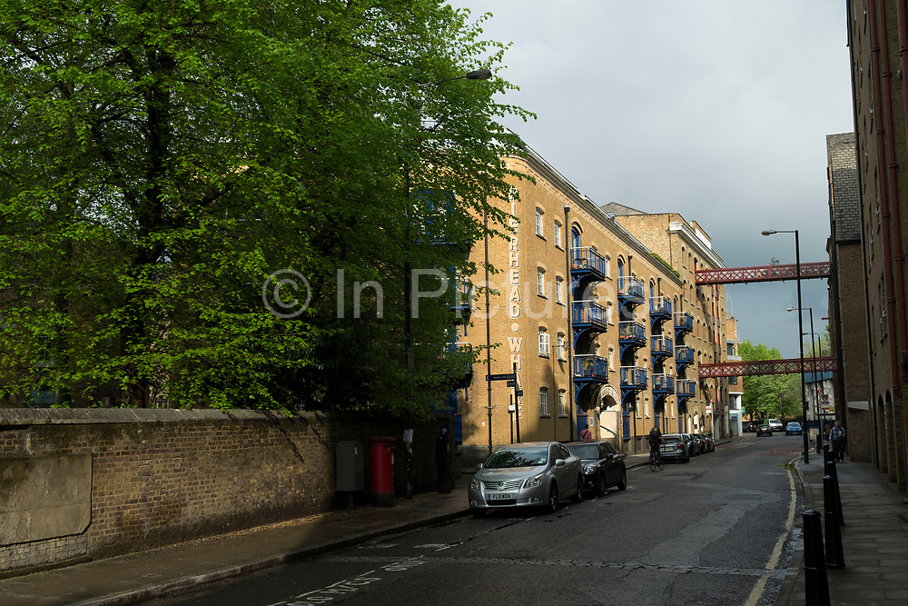 Wapping High Street is the famous street which once brought goods in from the central docks area of East London, United Kingdom. Lined with Wharf buildings this is truly part of historical London.