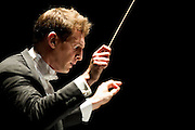 Evan Rogister conducts the Dallas Opera Orchestra at the Margot & Bill Winspear Opera House on Saturday, February 2, 2013 in Dallas, Texas. (Cooper Neill/The Dallas Morning News)