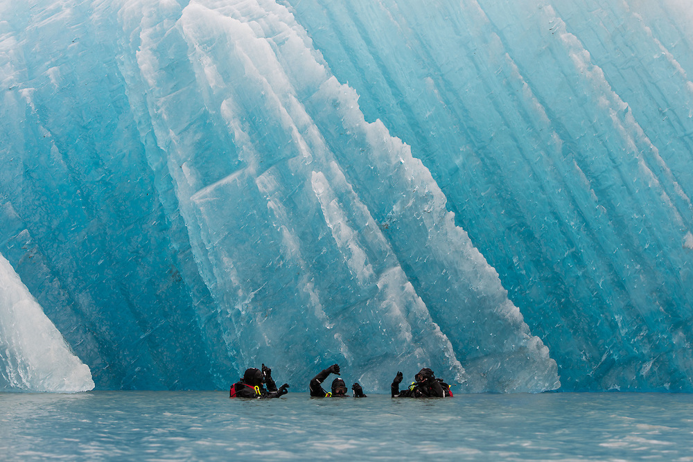 Scuba divers at Sum Dum Glacier near Juneau, Alaska. I was in awe of the spectrum of blues held in the ice, and the size of some of the icebergs that the glacier had birthed.