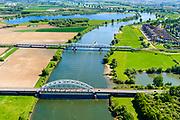 Nederland, Noord-Brabant, Den Bosch, 13-05-2019;  Fort Crèvecoeur, de  Maas in oostelijke richting. Treurenbrug en de spoorbrug over de Maas tussen Hedel en Crevecoeur. Er wordt gewerkt aan weerdverlaging omgeving Fort Crèvecoeur, maakt onderdeel uit van het Maasoeverpark. Landschapspark in wording met ruimte voor de natuur, voor de landbouw  én waterberging.<br /> Fort Crèvecoeur, the Maas in an easterly direction. Treurenbrug and the railway bridge over the Maas between Hedel and Crevecoeur. Work is underway to reduce the floodplains around Fort Crèvecoeur, part of the Maasoever Park. Landscape park in the making with room for nature, agriculture and water storage.<br /> <br /> aerial photo (additional fee required); luchtfoto (toeslag op standard tarieven); copyright foto/photo Siebe Swart