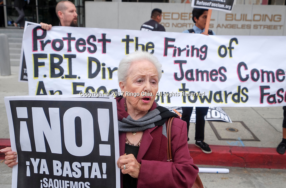 Members of Refuse Fascism protest the Tuesday firing of FBI director James Comey by President Donald Trump, outside the downtown Los Angeles federal building Wednesday, May 10, 2017.(Photo by Ringo Chiu/PHOTOFORMULA.com)<br /> <br /> Usage Notes: This content is intended for editorial use only. For other uses, additional clearances may be required.