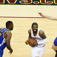 10 June 2016: Cleveland Cavaliers guard Kyrie Irving (2) drives past Golden State Warriors center Festus Ezeli (31) and Golden State Warriors guard Klay Thompson (11) during the Golden State Warriors 108-97 victory over the Cleveland Cavaliers, during Game Four of the 2016 NBA Finals at the Quicken Loans Arena, Cleveland, Ohio, USA.