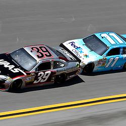 April 17, 2011; Talladega, AL, USA; NASCAR Sprint Cup Series driver Denny Hamlin (11) drafts Ryan Newman (39) during the Aarons 499 at Talladega Superspeedway.   Mandatory Credit: Derick E. Hingle