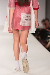 © Licensed to London News Pictures. 31/05/2014. London, England. Collection by Hollie Robinson from UCLAN, University of Central Lancashire. Graduate Fashion Week 2014, Runway Show at the Old Truman Brewery in London, United Kingdom. Photo credit: Bettina Strenske/LNP
