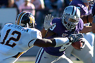 MANHATTAN, KS - NOVEMBER 17:  Running back James Johnson #8 of the Kansas State Wildcats rushes up field against pressure from linebacker Sean Weatherspoon #12 of the Missouri Tigers in the first half on November 17, 2007 at Bill Snyder Stadium in Manhattan, Kansas.  Missouri won the game 49-32.  (Photo by Peter Aiken/Getty Images)