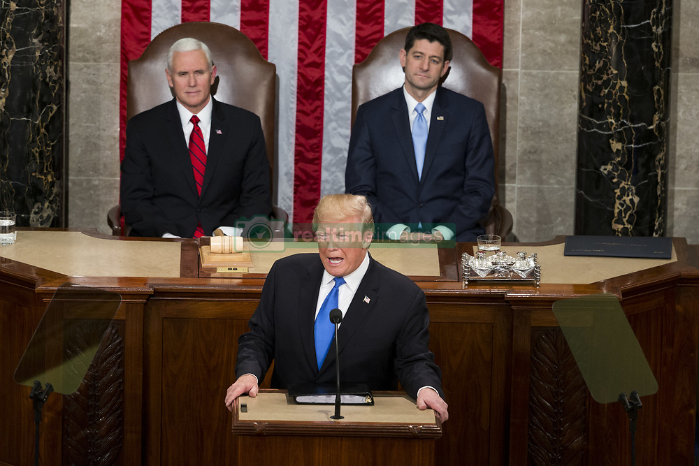 January 30, 2018 - Washington, District Of Columbia, U.S.- United States President DONALD J. TRUMP, flanked by Vice President MIKE PENCE, behind left, and House Speaker PAUL RYAN, delivers the State Of The Union Address to a joint session of the Congress at the United States Capitol. (Credit Image: © Alex Edelman via ZUMA Wire)