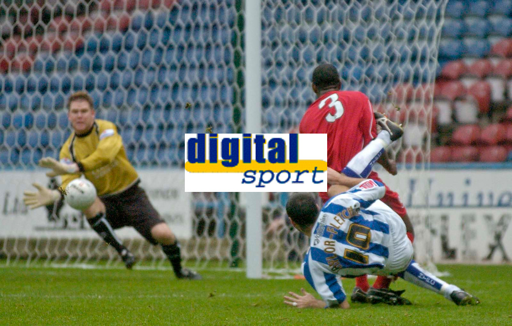 Photo: Glyn Thomas.<br />Huddersfield Town v Welling United. The FA Cup. 06/11/2005.<br />Welling's keeper Jamie Turner (L) makes an excellent save to deny Huddersfield's Gary Taylor-Fletcher (#10).