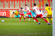 Stevenage and Walsall all run fro the ball during the EFL Sky Bet League 2 match between Stevenage and Walsall at the Lamex Stadium, Stevenage, England on 20 February 2021.