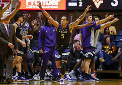 Feb 18, 2019; Morgantown, WV, USA; Kansas State Wildcats guard Barry Brown Jr. (5) celebrates after making a three pointer during the second half against the West Virginia Mountaineers at WVU Coliseum. Mandatory Credit: Ben Queen-USA TODAY Sports