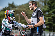 #469 (HERNANDEZ Stefany) VEN talking to Liam Phillips during practice at Round 5 of the 2018 UCI BMX Superscross World Cup in Zolder, Belgium