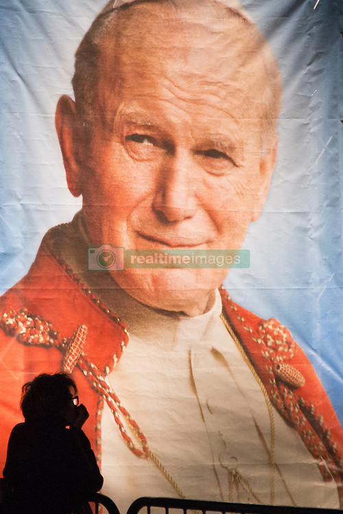 April 2, 2017 - Warsaw, Poland - A woman stands near John Paul II image during 12th anniversary of death of John Paul II in Warsaw on April 2, 2017. (Credit Image: © Maciej Luczniewski/NurPhoto via ZUMA Press)