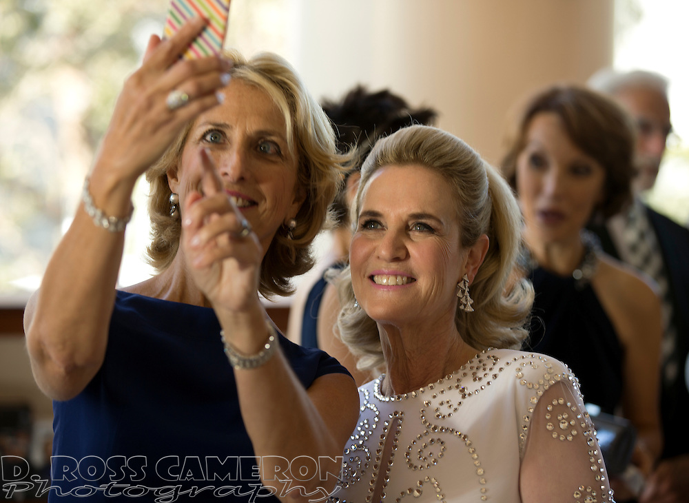 Gala Committee member Stephanie Harman, left, makes a selfie with Committee Chair Lisa Goldman at the opening of the San Francisco Symphony, Wednesday, Sept. 3, 2014 at Davies Symphony Hall in San Francisco. (Photo by D. Ross Cameron)