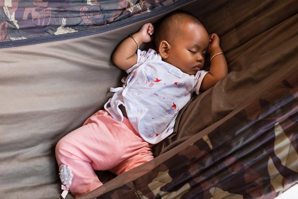 Kampot, Cambodia. Six months old Khmer Child sleeping in a Hammock. Photo by Lorenz Berna