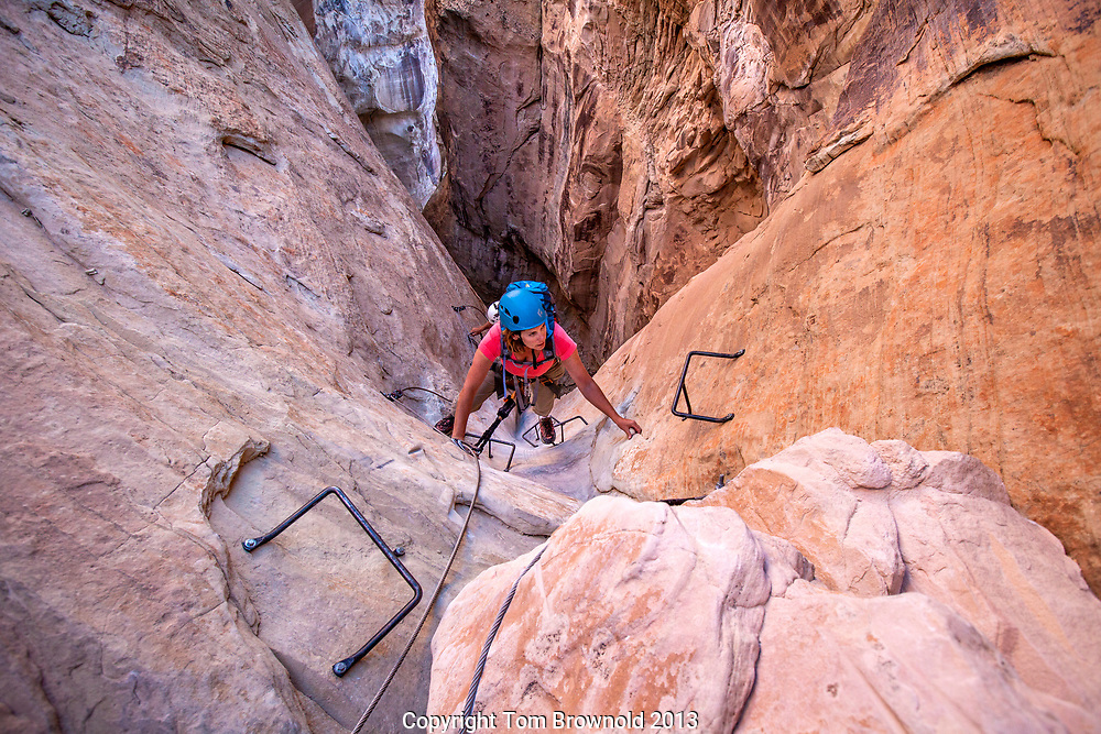 Climber on the Hoodoo via ferrata at Amangiri