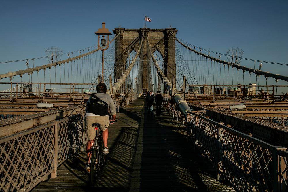 Bikers passing in Brooklyn bridge in New York.