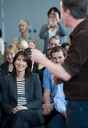 Leader of the Conservative Party David Cameron is watched by his wife Samantha as he delivers a speech at a rally at the Milton Keynes Academy, Saturday March 27, 2010.  Photo By Andrew Parsons / i-Images.