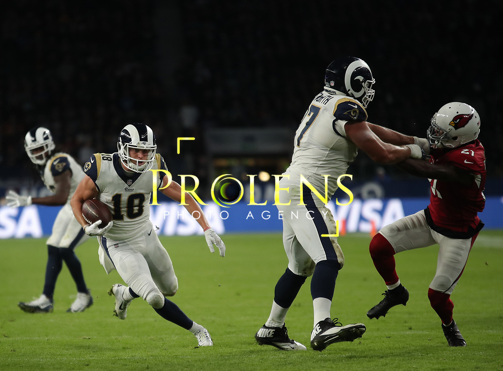 LONDON, ENGLAND - OCTOBER 22: Los Angeles Rams wide receiver Cooper Kupp (18) runs through for a touchdown during the NFL match between the Arizona Cardinals and the Los Angeles Rams at Twickenham Stadium on October 22, 2017 in London, United Kingdom. (Photo by Mitchell Gunn/ESPA-Images) *** Local Caption *** Cooper Kupp (18)