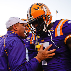 October 16, 2010; Baton Rouge, LA, USA; LSU Tigers head coach Les Miles talks to cornerback Patrick Peterson (7) prior to kickoff of a game against the McNeese State Cowboys at Tiger Stadium. LSU defeated McNeese State 32-10. Mandatory Credit: Derick E. Hingle