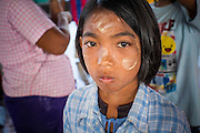 "30 OCTOBER 2012 - PATTANI, PATTANI, THAILAND: An immigrant worker from Myanmar (Burma) in the fishing port of Pattani, province of Pattani, Thailand. The woman has ""thanka' powder on her face, which Burmese use as sunscreen. Thailand's fishing industry relies on immigrant workers, mostly from Myanmar but also Laos and Cambodia. There have been allegations of worker abuse, including charges that workers are held in slave labor like conditions.  There are hundreds of thousands of immigrant workers in the Thai fishing industry. Most are from Myanmar (Burma) but there are also Cambodian and Laotian workers in the industry.    PHOTO BY JACK KURTZ"