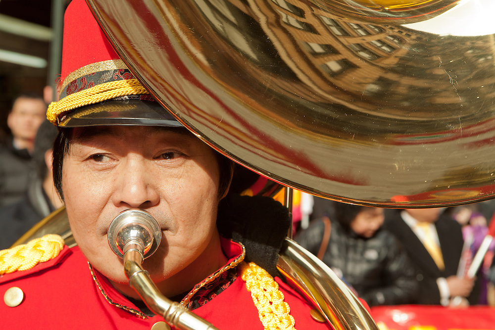 A Sousaphone player in one of several marching bands in the parade.
