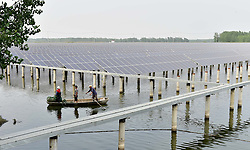 June 22, 2017 - Lianyungan, Lianyungan, China - Lianyungang, CHINA-June 21 2017: (EDITORIAL USE ONLY. CHINA OUT) A solar power plant is built upon a fishing ground in Lianyungang, east China's Jiangsu Province,making good use of natural resources. (Credit Image: © SIPA Asia via ZUMA Wire)