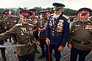 Russian Don Cossacks veterans of World War II in uniform before a blessing at the Ascension Cathedral in Novocherkassk, Russia. The men are participating in the annual Cossack Festival gathering of units from around Russia.