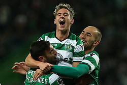 December 17, 2017 - Lisbon, Lisbon, Portugal - Sportings midfielder Bruno Fernandes from Portugal (L) celebrating after scoring a goal with Sportings forward Daniel Podence from Portugal (C) and Sportings forward Bas Dost from Holland (R) during Premier League 2017/18 match between Sporting CP and Portimonense SC,.at Alvalade Stadium in Lisbon on December 17, 2017. (Credit Image: © Dpi/NurPhoto via ZUMA Press)