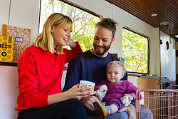Mail Online: Couple Kim Marren, 31, a model and partner Maarten Ketels an actor, together with their one-year-old daughter Willow live on their barge Sunshine which started out as an empty shell and is now a small but comfortable home currently moored on the Lea Navigation in East London. North Hackney, London, November 02 2018.
