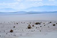 Layers of a valley, dunes, a sandstorm, mountains and clouds in White Sands National Monument in New Mexico.