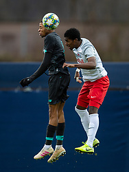 GRÖDIG, AUSTRIA - Tuesday, December 10, 2019: Liverpool's Elijah Dixon-Bonner (L) challenges for a header with FC Salzburg's substitute Bryan Okoh during the final UEFA Youth League Group E match between FC Salzburg and Liverpool FC at the Untersberg-Arena. (Pic by David Rawcliffe/Propaganda)