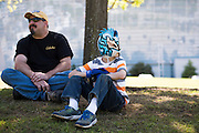 Parker Stockholm (9) sits in the shade outside WrestleMania on April 3, 2016 in Arlington, Texas.