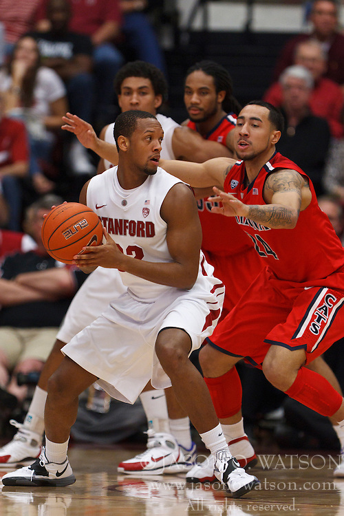Feb 4, 2012; Stanford CA, USA; Stanford Cardinal guard Jarrett Mann (22) is guarded by Arizona Wildcats guard Brendon Lavender (24)  during the second half at Maples Pavilion.  Arizona defeated Stanford 56-43. Mandatory Credit: Jason O. Watson-US PRESSWIRE