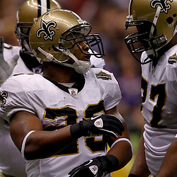 September 9, 2010; New Orleans, LA, USA; New Orleans Saints running back Pierre Thomas (23) celebrates with teammate guard Carl Nicks (77) after scoring a touchdown against the Minnesota Vikings during the NFL Kickoff season opener at the Louisiana Superdome. The New Orleans Saints defeated the Minnesota Vikings 14-9.  Mandatory Credit: Derick E. Hingle