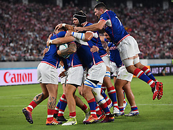 Russia's Kirill Golosnitsky is congratulated by his team-mates after scoring his sides first try during the Pool A match between Japan and Russia at the Tokyo Stadium, Tokyo, Japan. Picture date: Friday September 20, 2019. See PA story RUGBYU Japan. Photo credit should read: Ashley Western/PA Wire. RESTRICTIONS: Editorial use only. Strictly no commercial use or association. Still image use only. Use implies acceptance of RWC 2019 T&Cs (in particular Section 5 of RWC 2019 T&Cs) at: https://bit.ly/2knOId6