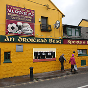 A street scene in Dingle, County Kerry, Ireland, showing An Droicead Beag, a famous pub in Dingle. Dingle is the only town on the Dingle Peninsula. Principal industries in the town are tourism, fishing and agriculture. Dingle, County Kerry, Ireland. Photo Tim Clayton