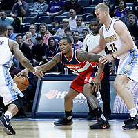 08 March 2017: Denver Nuggets guard Jameer Nelson (1) and Denver Nuggets center Mason Plumlee (24) defend on Washington Wizards guard Bradley Beal (3) during the Washington Wizards 123-113 victory over the Denver Nuggets, at the Pepsi Center, Denver, Colorado, USA.