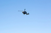 Wildcat combat helicopter flying in sky over military training area, Upavon Down, Salisbury Plain, Wiltshire, England, UK