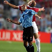 Uruguay's Gustavo Varela and Denmark's Thomas Gravesen