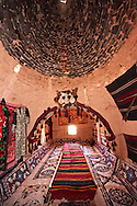 """Pictures of the beehive adobe buildings of Harran, south west Anatolia, Turkey.  Harran was a major ancient city in Upper Mesopotamia whose site is near the modern village of Altınbaşak, Turkey, 24 miles (44 kilometers) southeast of Şanlıurfa. The location is in a district of Şanlıurfa Province that is also named """"Harran"""". Harran is famous for its traditional 'beehive' adobe houses, constructed entirely without wood. The design of these makes them cool inside.  6 .<br /> <br /> If you prefer to buy from our ALAMY PHOTO LIBRARY  Collection visit : https://www.alamy.com/portfolio/paul-williams-funkystock/harran.html<br /> <br /> Visit our TURKEY PHOTO COLLECTIONS for more photos to download or buy as wall art prints https://funkystock.photoshelter.com/gallery-collection/3f-Pictures-of-Turkey-Turkey-Photos-Images-Fotos/C0000U.hJWkZxAbg ."""