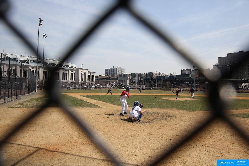 A baseball team practice in Heritage Field next to Yankee Stadium before the New York Yankees Vs Toronto Blue Jays season opening day at Yankee Stadium, The Bronx, New York. 6th April 2015. Photo Tim Clayton