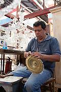 Man fixing artifacts in the Mercado de las Pulgas (flea market), Palermo, Buenos Aires, Federal District, Argentina.