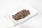 Cutout of Freshly Ground Black pepper (Piper nigrum) on white background