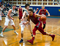 Kingswood's Josh Duntley and Belmont's Dylan Gansert during the boys final for the holiday basketball tournament Friday evening.  (Karen Bobotas/for the Laconia Daily Sun)