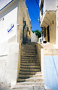 Narrow street stone steps leading to traditional houses in old part of city, Tangier, Morocco, north Africa