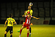 Harrogate Town's Ed Francis wins a header over Exeter City's Matt Jay  during the EFL Sky Bet League 2 match between Harrogate Town and Exeter City at the EnviroVent Stadium, Harrogate, United Kingdom on 19 January 2021.