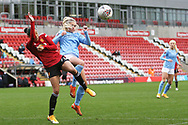 Manchester United forward Christen Press (24) and Manchester City midfielder Laura Coombs (7) battle for possession during the FA Women's Super League match between Manchester United Women and Manchester City Women at Leigh Sports Village, Leigh, United Kingdom on 14 November 2020.